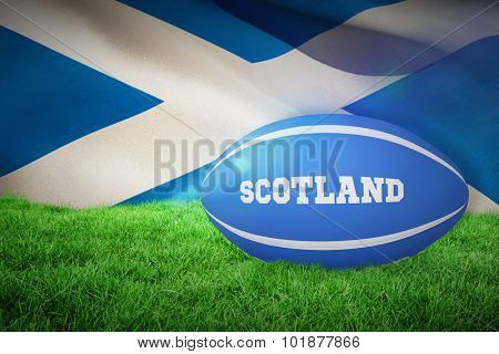 Scotland rugby ball against flag of scotland