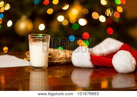 Closeup Of Glass Of Milk And Cookies For Santa On Table