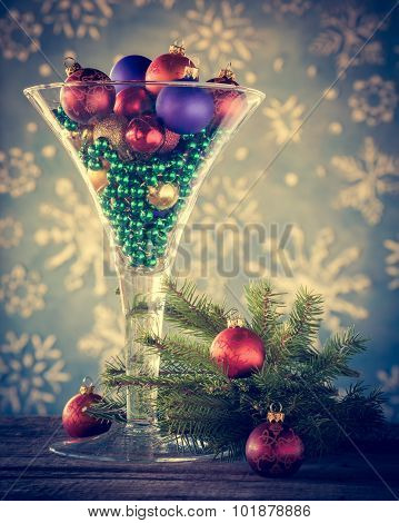 Christmas Decoration - Wine Glass Filled With Christmas Tree Balls As Festive Cocktail. Retro Styled