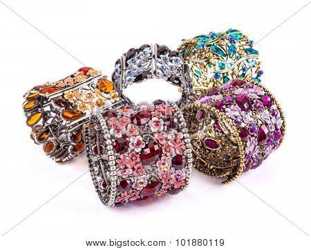 Colorful bracelets stone on white background.
