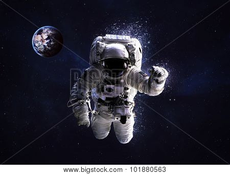 Astronaut in outer space against the backdrop of planet