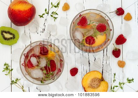 Healthy detox fruit infused flavored water. Top view. Summer refreshing homemade cocktail with fruit