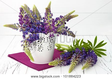 Meadow Flowers Lupines Bouquet In White Decorative Bucket On Vintage White Wooden Table