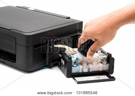 Refilling The Ink Printer.
