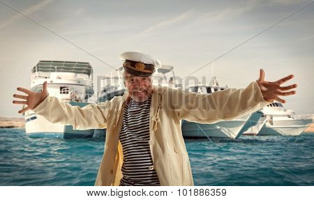 Captain. Happy sailor man on ocean background