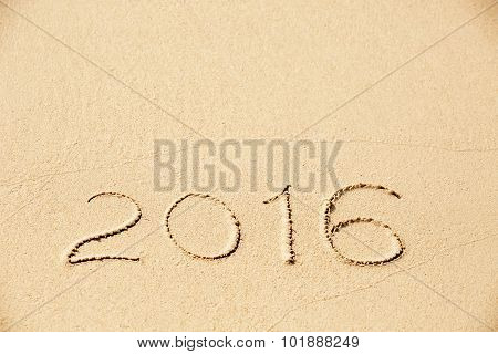 2016 Inscription Written In The Wet Yellow Beach Sand