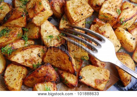 roasted potatoes and fork