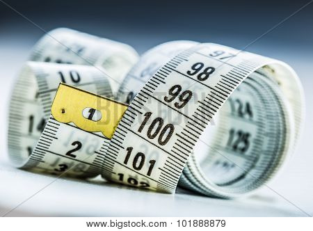 Curved measuring tape. Measuring tape of the tailor.