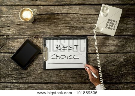 Overhead View Of Male Hand Writing Best Choice On White Sheet Of Paper