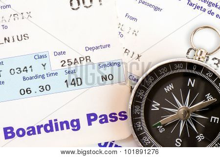 Air Travel Boarding Pass And Compass