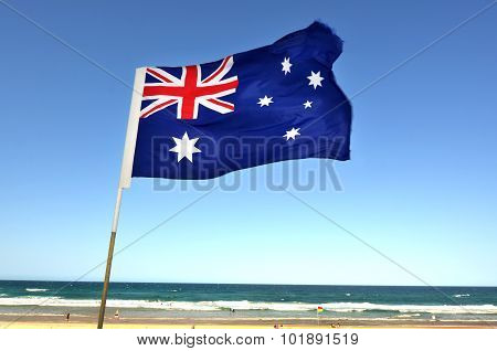 The National flag of Australia flay over the Gold Coast in Queensland Australia.