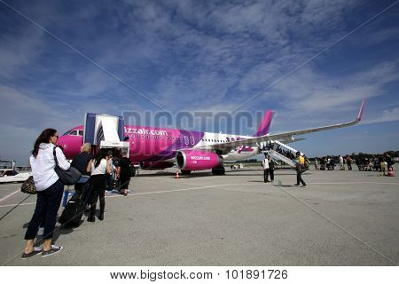 BUDAPEST, HUNGARY - FRIDAY, AUGUST 21, 2015: Passengers ready to board a WizzAir A319. WizzAir is a Central European low-cost airline.  Photographer: Mark Milstein/ Northfoto