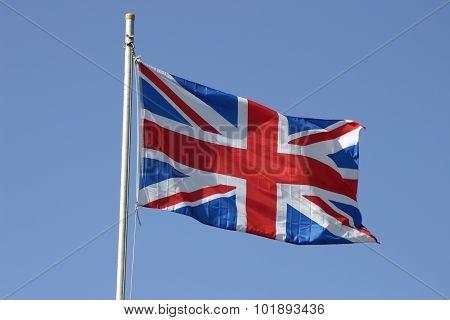 Union Jack flag flying on a flagpole
