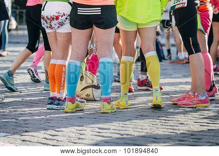 girls legs in bright sneakers