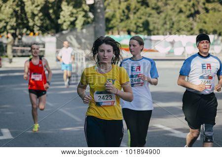 girl running during marathon