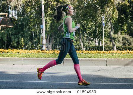 female athlete running during marathon