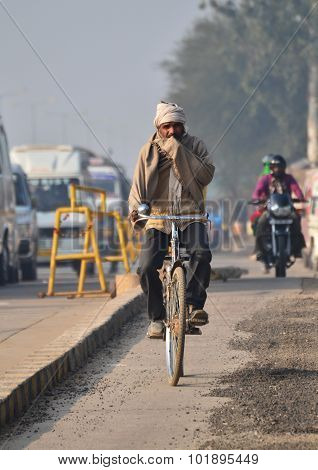 Jaipur, India - December 30, 2014: Indian People Riding A Bicycle In Jaipur