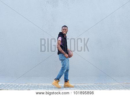 Smiling African American Man Walking With Basketball