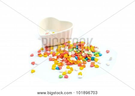 Colorful Heart Cake Sprinkles and Cup isolated in white background