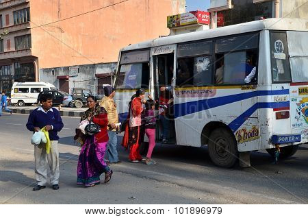 Jaipur, India - December 30, 2014: Indian People Taking A Bus In Jaipur