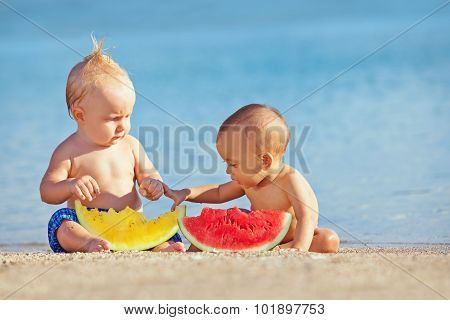 Children After Swimming Have Fun And Eat Fruits On Beach