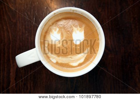 A persons first attempt at Latte Art. Latte Art is made from steamed milk poured into a cup of hot coffee in a design to please the thirsty customer. Latte art is a reconised art form by many