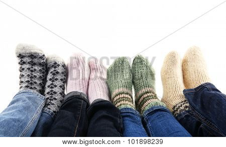Human feet in knitted socks isolated on white