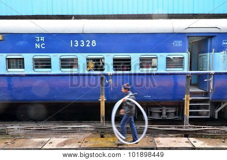 Aipur, India - January 3, 2015: Passengers At The Window Of A Indian Railway Train