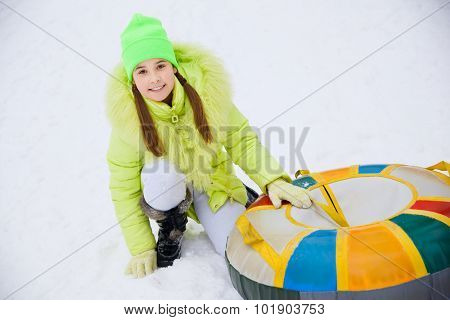 Girl on a Snow Tube Winter Activity