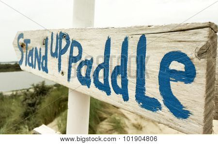 Signpost showing the term stand up paddle