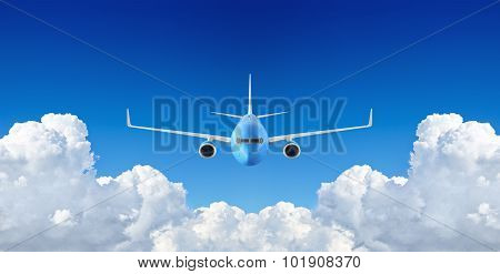Passenger Airplane Flying In The Blue Sky Among The Clouds
