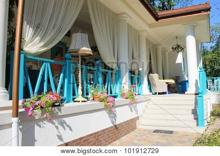Beautiful Terrace With Bright Colored Furniture In Country Restaurant