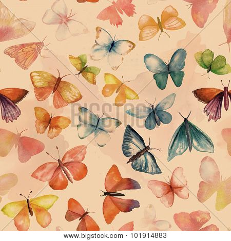 A seamless background pattern with many watercolour butterflies