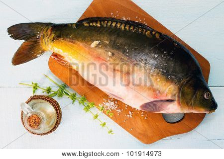 Raw Fish (tench?) On A Wooden Cutting Board, Top View