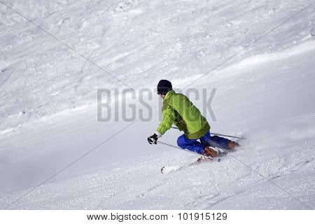 Skier on the ski piste, extreme winter sport