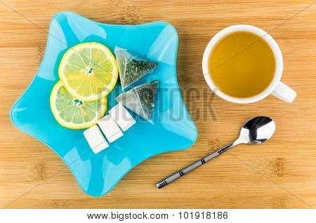 Tea, Slices Of Lemon, Lumpy Sugar In Blue Plate