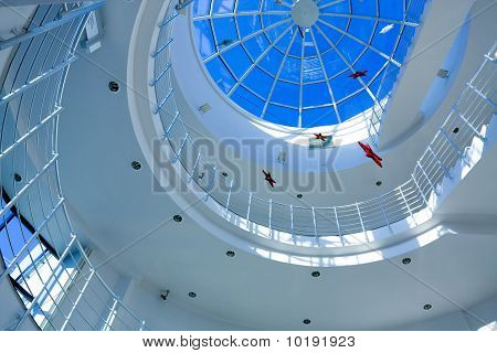 Abstract blue geometric ceiling in office center