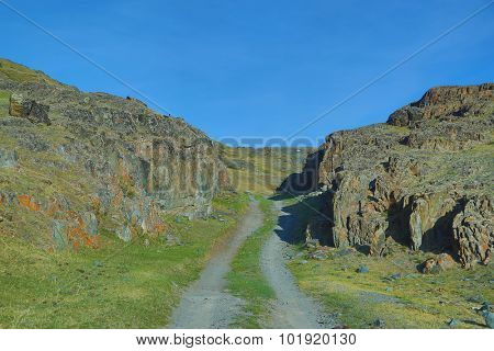mountain road between the rocks in Russia, Altay