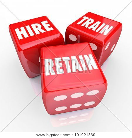 Hire, Train and Retain words on 3 red dice to illustrate challenges in attracting, employing and keeping workers for a business or company