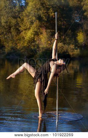Beautiful Girl Posing Near A Pole Dance.