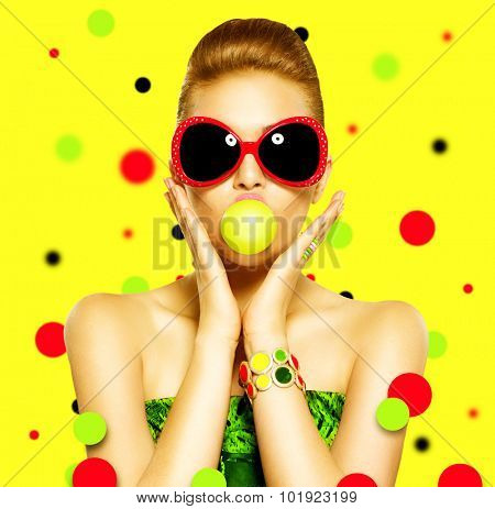Beauty surprised fashion funny model girl wearing sunglasses. Young girl with green bubble of chewing gum. makeup isolated over white background. Expressing positive emotions, smile. Beautiful woman
