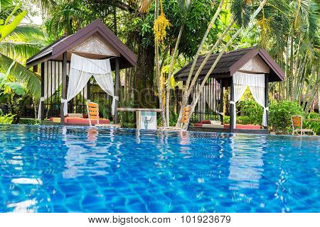 Place for Thai massage at beautiful swimming pool in tropical resort, Koh Chang island, Thailand.