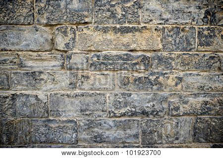 Stone wall background at high resolution.