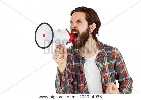 Handsome hipster shouting through megaphone on white background