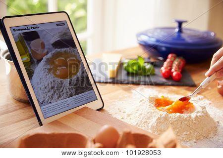 Person Following Pasta Recipe Using App On Digital Tablet