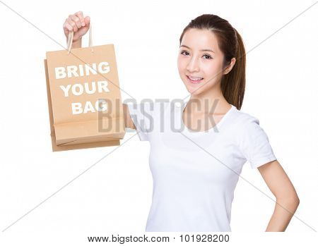 Woman hold with shopping bag and showing phrase of bring your bag