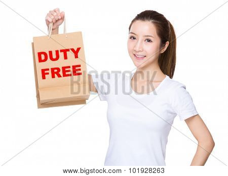 Woman hold with shopping bag and showing phrase of duty free