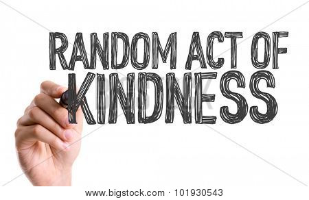Hand with marker writing the word Random Act of Kindness