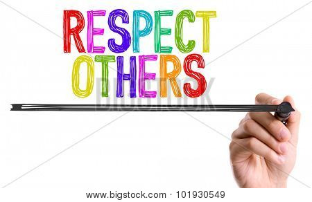 Hand with marker writing the word Respect Others