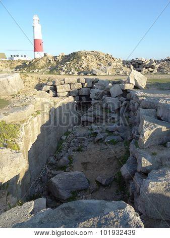 Lighthouse And Rock Pile Cliffs Seascape